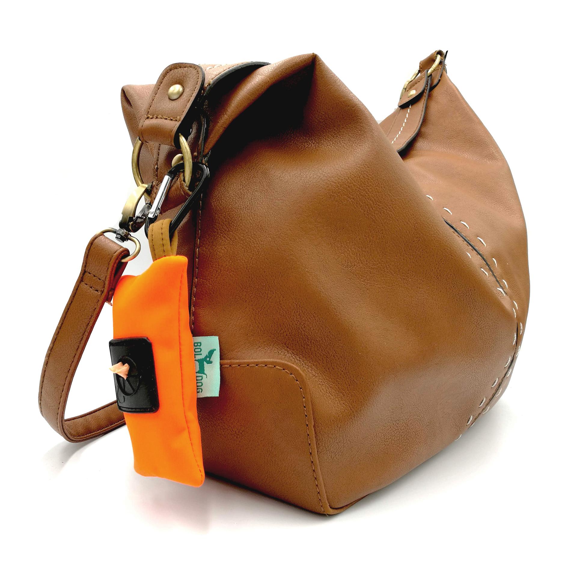 Orange color dog poop bag holder.